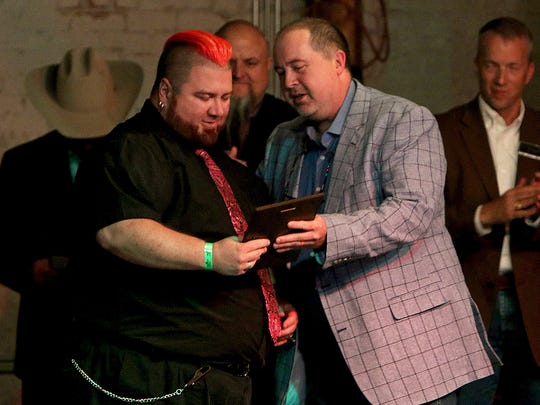 In this file photo, Artist Franklin O'Neal (left) is given the Bruce Sankey Contributor of the Year Award by Tom Brewster, a board member of the Professional Wrestling Hall of Fame, during the 16th annual Induction Banquet. This year's banquet will be held May 18.