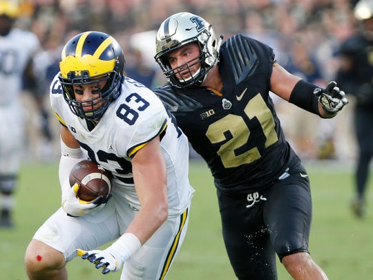 Markus Bailey of Purdue chases down Michigan tight end Zach Gentry in the second half Saturday, September 23, 2017, at Ross-Ade Stadium. Purdue fell to Michigan 28-10.