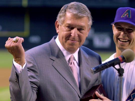 Former Diamondbacks owner Jerry Colangelo (left) shows