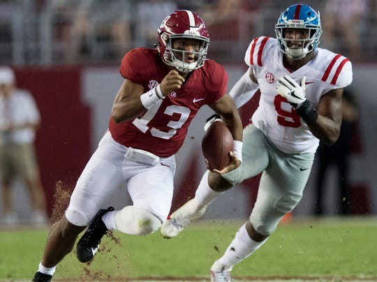 Alabama quarterback Tua Tagovailoa (13) carries against Ole Miss in second half action at Bryant-Denny Stadium in Tuscaloosa, Ala. on Saturday September 30, 2017. (Mickey Welsh / Montgomery Advertiser)