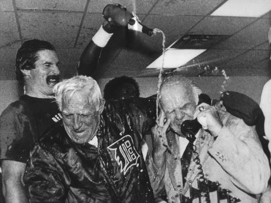 Oct. 14, 1984: Detroit Tigers' Jack Morris pouring champagne on team president Jack Campbell, right, and manager Sparky Anderson, as Campbell takes a congratulatory phone call from President Ronald Reagan, after the Tigers defeated the Padres to win the World Series.