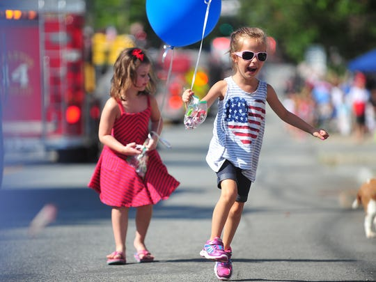 Lindsey Rogoff, 5, of Flanders dances back to her seat after scoring a piece of candy. Lindsey Rogoff, 5, of Flanders, dances back to her seat after scoring a piece of candy. Mendham celebrates Labor Day with its annual parade.