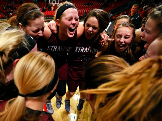 Strafford players celebrate after the end of the MSHSAA