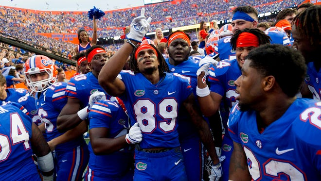 Florida wide receiver Tyrie Cleveland (89) celebrates with fellow teammates after making the winning touchdown during the Tennessee Volunteers vs. Florida Gators game at Ben Hill Griffin Stadium in Gainesville, Florida on Saturday, September 16, 2017.