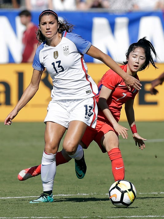 South Korea's Lee Mina (7) chases United States' Alex Morgan (13) during the first half of an international friendly women's soccer match in Cary, N.C., Sunday, Oct. 22, 2017. (AP Photo/Gerry Broome)