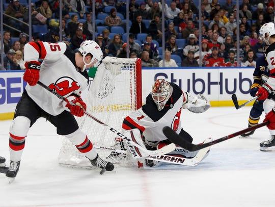 New Jersey Devils defenseman Mirco Mueller (25) tries