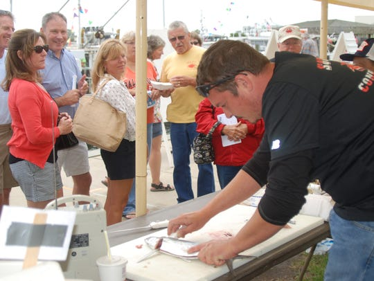 Jim Hinman shows how to properly filet a fish.