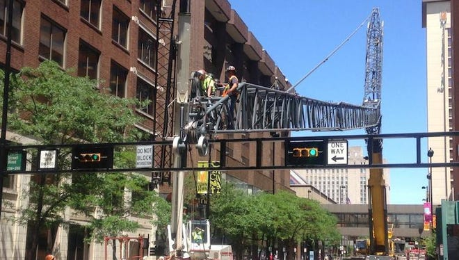 Crews have blocked off Elm Street between Fourth and Fifth streets in downtown Cincinnati.