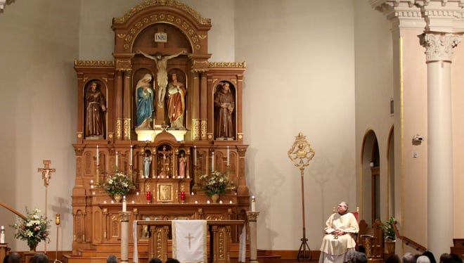 Parishoners at St. Mary's Basilica at Downtown Phoenix gather for the noon mass on Feb. 2.