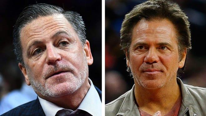 Cleveland Cavaliers owner Dan Gilbert, left, and Detroit Pistons owner Tom Gores