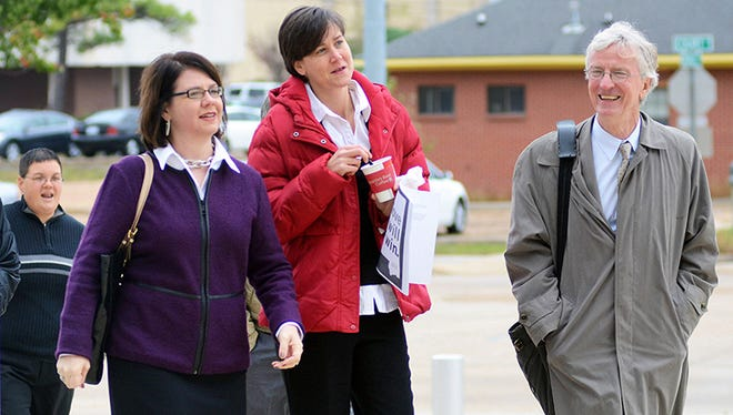 Plaintiffs Jocelyn Pritchett, left, her partner, Carla Webb, and attorney Robert McDuff arrive at the U.S. Federal Courthouse Wednesday in Jackson. The same-sex couple are seeking to have the state recognize the existing legal marriage performed in Maine.