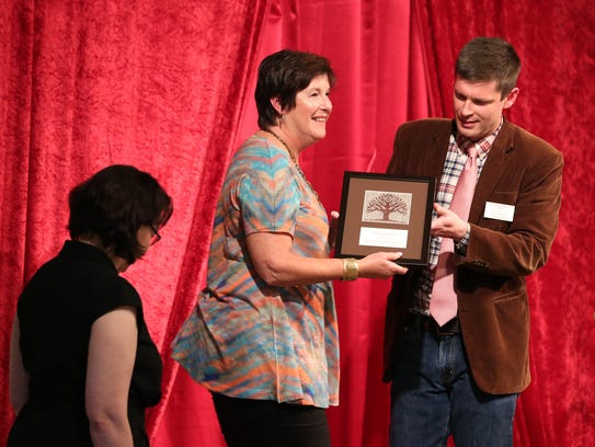 Lisa Joyce, left, and Nancy Moen accept the Heritage
