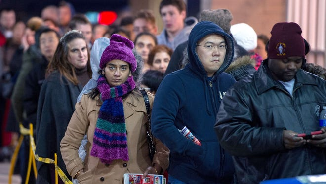 Shoppers wait in line to get into a Toys R Us store in Fairfax, Va., to score Black Friday shopping deals.