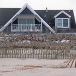 This Jan. 29, 2016 photo shows an oceanfront home in Point Pleasant Beach, N.J. owned by Todd Christie, the brother of Republican presidential candidate, New Jersey Gov. Chris Christie. The governor's environmental protection department wants to seize a strip of beach behind his brother's house as part of a protective dune system. (AP Photo/Wayne Parry)