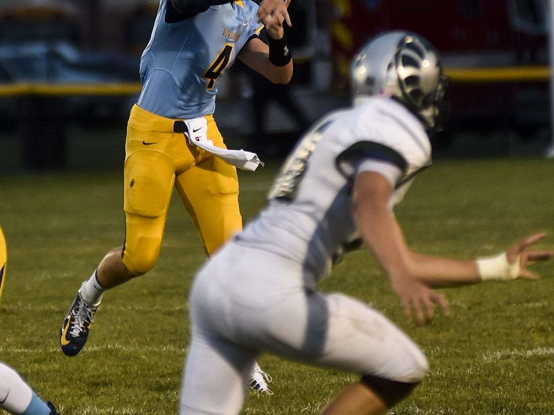 River Valley's Jax Harville fires off a pass during the Madison vs River Valley football game on Friday.