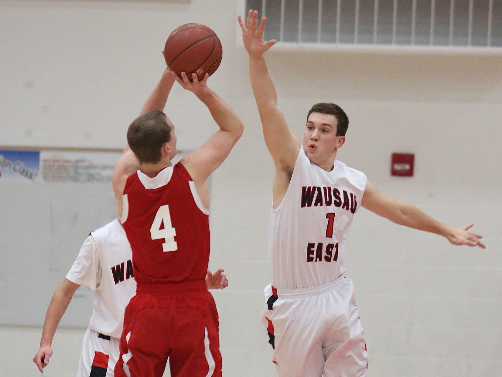Thomas Dunbar, right, is one of three returning varsity players for the Wausau East boys basketball team this season.
