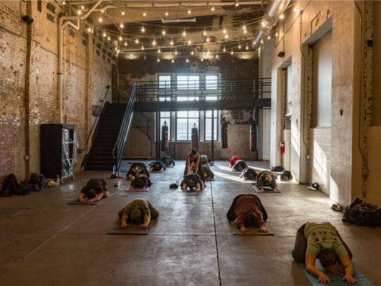 Workers at Rheingeist, performing yoga at the Over-the-Rhine