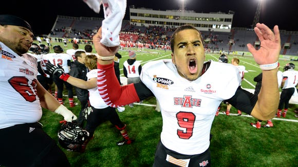 Arkansas State quarterback Fredi Knighten (9) tries to pump up the crowd in the final seconds of the fourth quarter against the Ball State Cardinals at Ladd-Peebles Stadium.