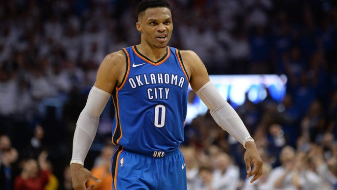 Oklahoma City Thunder guard Russell Westbrook (0) reacts after a play against the Utah Jazz during the fourth quarter in game five of the first round of the 2018 NBA Playoffs at Chesapeake Energy Arena.