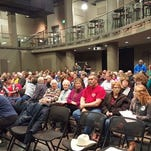 Indianola Republicans gather in the Black Box Theater at Kent Campus Center to caucus Feb. 1.