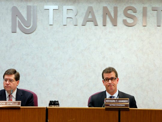 New Jersey Transit Acting Commissioner Richard T. Hammer (right) is shown during a board meeting in Newark, NJ, Wednesday, March 9, 2016.   The agency is facing a possible strike by the rail union.  Board member John Spinello is shown at left.