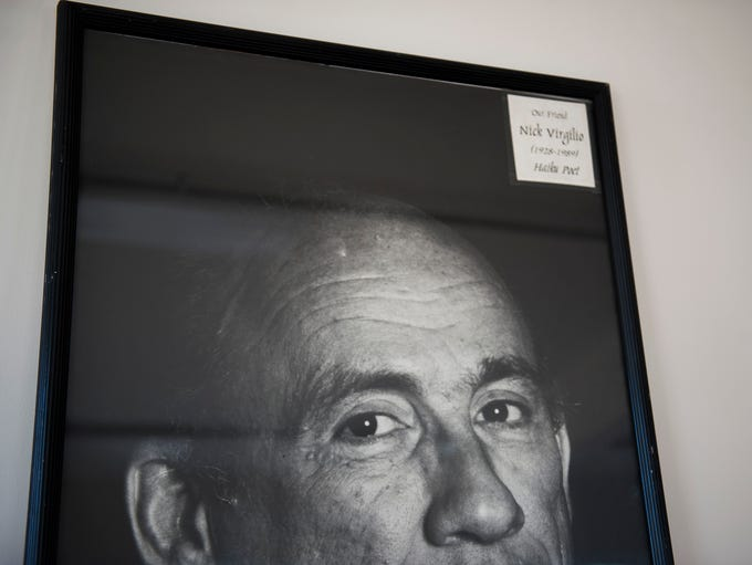 A framed photo of Nick Virgilio sits atop a mantle