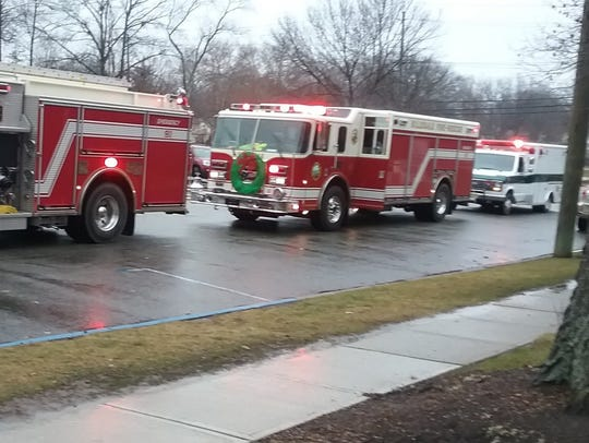 A procession of firetrucks brought the donated food