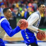 Kentucky's Tyler Ulis and Jamal Murray have some fun shooting during practice Wednesday afternoon at Wells Fargo Arena in Des Moines before Thursday's NCAA tournament game.