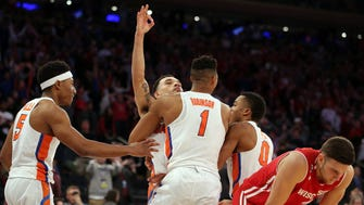 Florida Gators guard Chris Chiozza (11) celebrates making the game winning shot against the Wisconsin Badgers in the semifinals of the East Regional of the 2017 NCAA Tournament at Madison Square Garden.