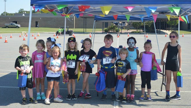 Some of the youngest super heroes who participated in the Fairview Titans' Superhero Family 5K Run/Walk event Sunday, September 25, 2016.