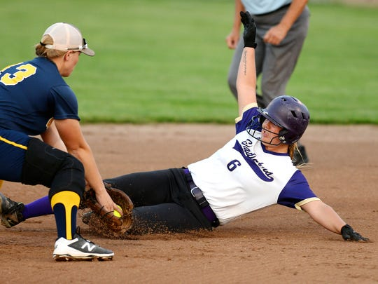 Fowlerville's Ginelle Leslie, shown sliding, hit a walk-off homer in the first game and another homer in the second game in a sweep of St. Johns.