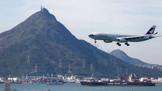 A Cathay Pacific Airways jetliner prepares to land at Hong Kong International Airport on Aug. 15, 2017.