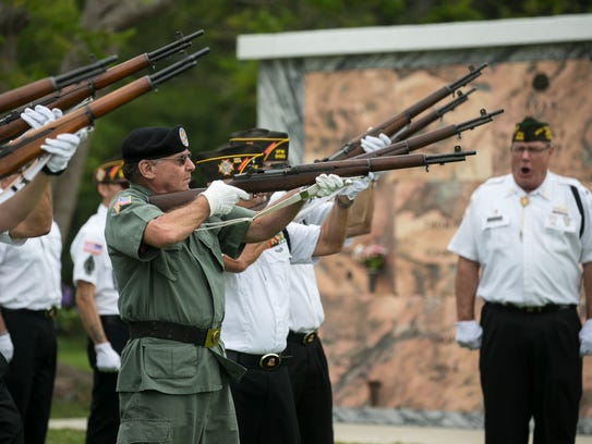 The Harney Point VFW honor guard gives the 21-gun salute