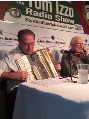 Tom Izzo plays the accordion during his radio show Monday.
