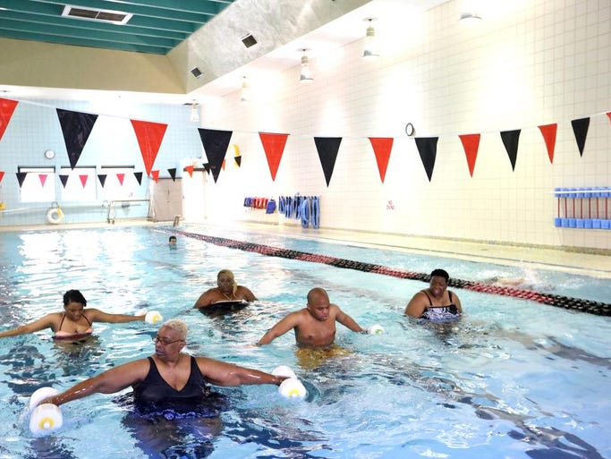 Karen Phillip, front left, participates in hydro cycling with niece Taylor Frazier, back left; sister Carla Drane, back; nephew Myles Frazier, second from right and sister Penny Wales, right, at the YMCA in Louisville. Apr. 9, 2014.