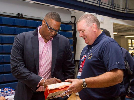 "PIstons ""Bad Boy"" Rick Mahorn signs a Wheaties box for SC4 Vice President of Student Services Pete Lacey at the 2017 Night of Champions benefit for the YMCA of the Blue Water Area Oct. 26."