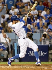 The Dodgers' Chris Taylor hits an RBI single against the Diamondbacks in the fourth inning of Los Angeles' NLDS Game 4 win on Saturday.