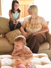 Lauren Bowie with her eldest daughter Fenley Grace and younger daughter Emerson relax at their home in Jackson.