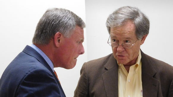 Sen. Richard Burr, left, listens to local resident