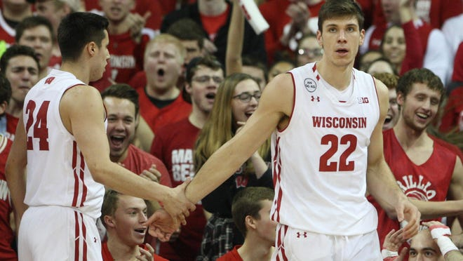 Ethan Happ (22) and Bronson Koenig (24) are part of a trio, along with Nigel Hayes, that might be the best in the Big Ten.