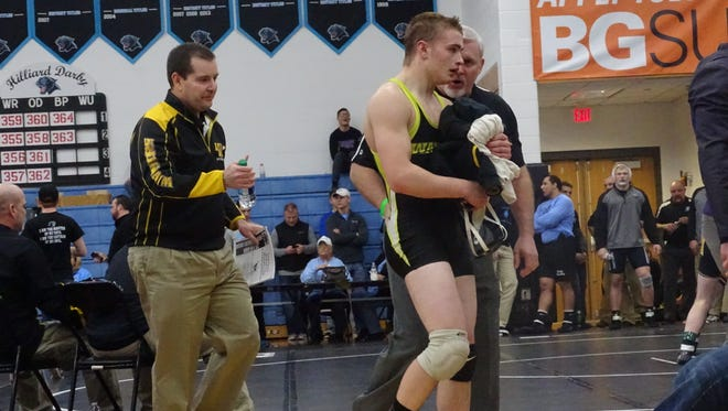 Watkins Memorial freshman Cole Foor talks to assistant coach Nick Lieb this past Saturday following Foor's 160-pound consolation victory to secure his state berth during the Division I district tournament at Hilliard Darby.