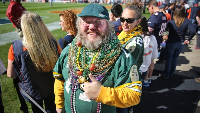 Russell Beckman of Green Bay is decked out with his Mardi Gras necklaces and Packers gear before the Bears-Packers game Sept.13, 2015, at Soldier Field in Chicago.