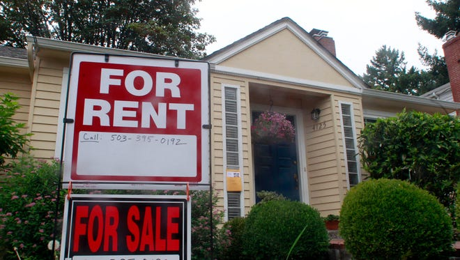 A house with signs for rent and for sale in Portland, Ore. (Sept. 13, 2011, photo)