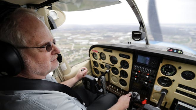 """Mike Callahan, a pilot with the state Department of Natural Resources, takes to the air to show how he tracks wildlife and detects wildfires. """"We help coordinate it from the air,"""" he said of the battle against wildfires."""
