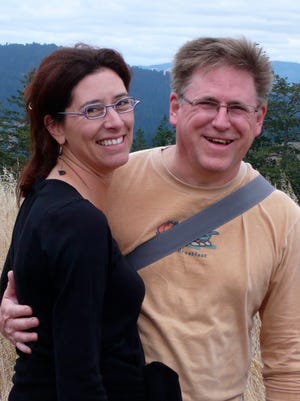 The late Donna Decker and writer C.J. Hribal enjoy a moment in 2009. A prizewinning story by Hribal draws on things the couple experienced when she had an aggressive form of cancer.