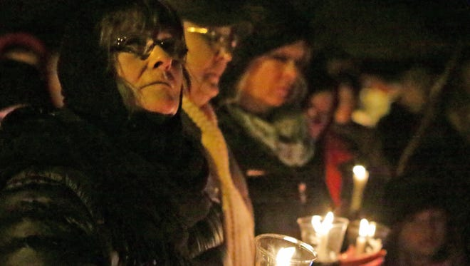 Locals gather for a candlelight vigil for the three Sheboygan Falls children of the Maki family Jan. 29, 2016 at River Park in Sheboygan Falls.