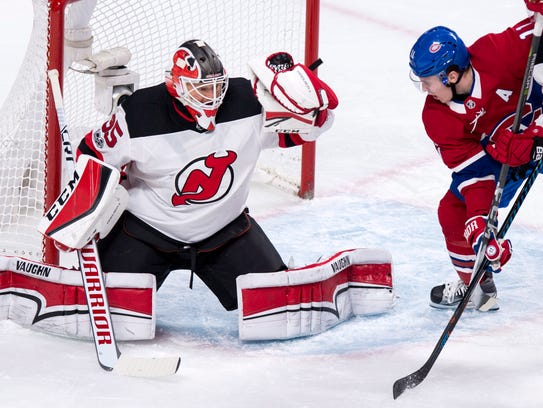 New Jersey Devils goaltender Cory Schneider snags the