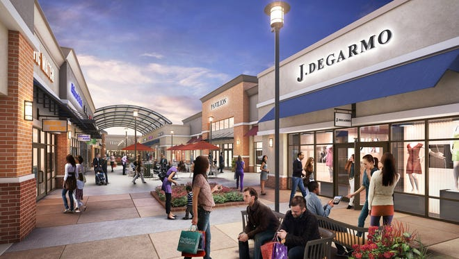 New England Development and Paragon Outlet Partners plan to develop a 325,000-square-foot outlet center on I-94 in Romulus opposite Detroit Metro Airport.