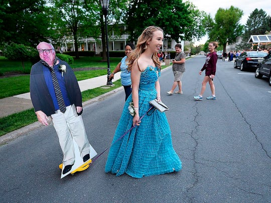 Allison Closs arrives for the Carlisle High School senior prom at Letort View Community Center at Carlisle Barracks in Carlise, Pa., on Friday, May 11, 2018.  Closs and her famous two-dimensional date joined other Carlisle High School seniors Friday for prom. Closs purchased the cutout of DeVito online along with a scooter she used to move the figure with.