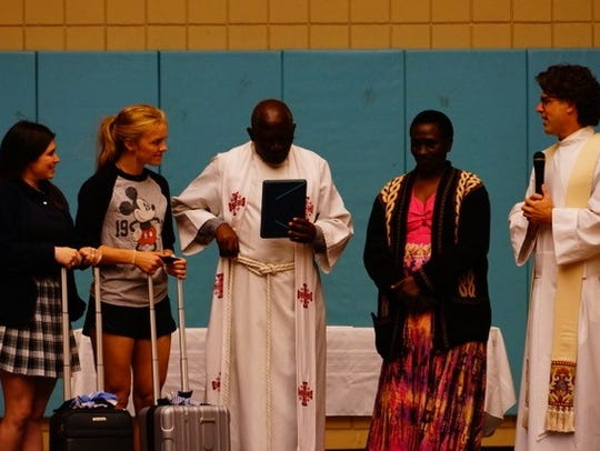 Students from AES' Sugar Mill Pond campus present Rev.